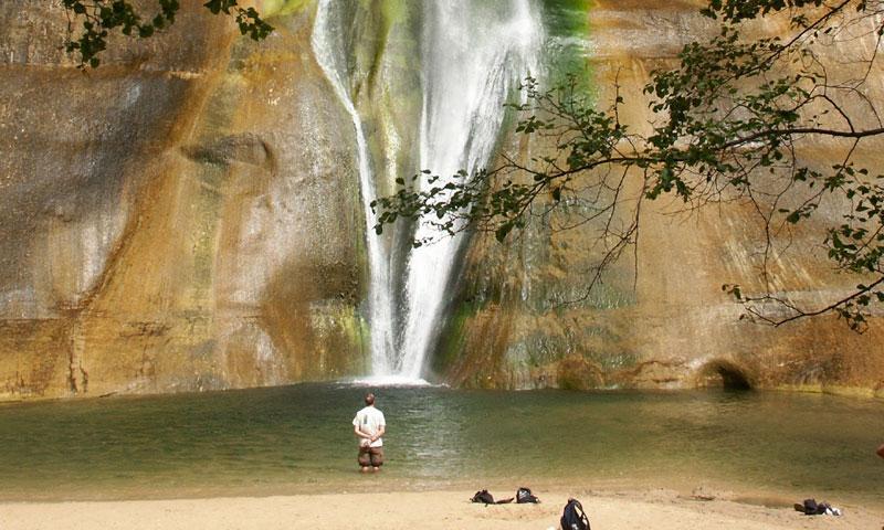 Taking a dip at the base of Calf Creek Falls